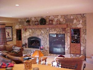 with a big fire place in a stone wall.